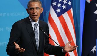 President Barack Obama gestures as he answers a question from the media during a press conference at the conclusion of the G-20 summit in Brisbane, Australia, Sunday, Nov. 16, 2014. (Associated Press) **FILE**