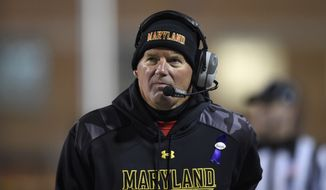 Maryland coach Randy Edsall watches during the first half of an NCAA college football game against Michigan State, Saturday, Nov. 15, 2014, in College Park, Md. (AP Photo/Nick Wass) **FILE**