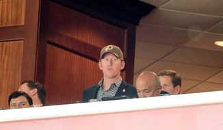 Former Navy SEAL Rob O'Neill, the man who says he was the shooter who killed Osama Bin Laden, sits in Washington Redskins Owner Dan Snyder's box as the Washington Redskins play the Tampa Bay Buccaneers in NFL football at FedExField, Landover, Md., Sunday, November 16, 2014. (Andrew Harnik/The Washin(...)