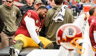 Washington Redskins tackle Trent Williams (71) leaves the game with a leg injury in the first quarter as the Washington Redskins play the Tampa Bay Buccaneers in NFL football at FedExField, Landover, Md., Sunday, November 16, 2014. (Andrew Harnik/The Washington Times)