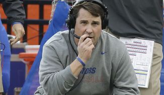 Florida head coach Will Muschamp watches from the sideline as South Carolina is about to score a touchdown to tie the game and send it in to overtime late in the second half of an NCAA college football game in Gainesville, Fla., Saturday, Nov. 15, 2014. South Carolina won in overtime 23-20. (AP Photo/John Raoux)