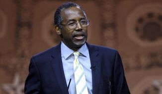 Ben Carson, professor emeritus at Johns Hopkins School of Medicine, speaks in National Harbor, Md., in this March 8, 2014, file photo. (AP Photo/Susan Walsh, File)