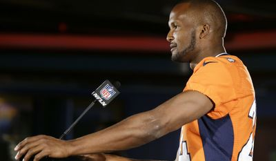 Denver Broncos cornerback Champ Bailey talks with reporters during a news conference Wednesday, Jan. 29, 2014, in Jersey City, N.J. The Broncos are scheduled to play the Seattle Seahawks in the NFL Super Bowl XLVIII football game Sunday, Feb. 2, in East Rutherford, N.J. (AP Photo/Mark Humphrey)