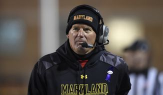 Maryland coach Randy Edsall watches during the first half of an NCAA college football game against Michigan State, Saturday, Nov. 15, 2014, in College Park, Md. (AP Photo/Nick Wass)