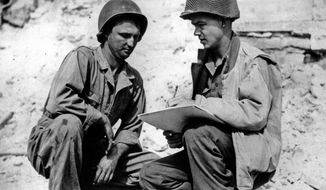 FILE - This May 1, 1944 file photo shows Stars and Stripes artist Sgt. Bill Mauldin sketching Pvt. Robert L. Bowman, left, of Hogansville, Ga., on the Anzio beachhead in Italy during World War II. Two dozen original editorial cartoons created by Mauldin, a Pulitzer Prize-winning cartoonist and World War II veteran are set to hit the auction block as part of a major comic art auction in Beverly Hills, Calif. A native of New Mexico, Bill Mauldin became known during World War II for his Willie and Joe characters. He lifted the spirits of U.S. soldiers through the cartoons, which used edgy humor to depict the horrors of war. (AP Photo/File)
