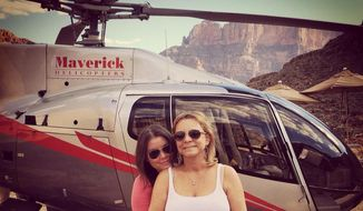 "FILE - In this Oct. 21, 2014 file photo provided by TheBrittanyFund.org, Brittany Maynard, left, hugs her mother Debbie Ziegler next to a helicopter at the Grand Canyon National Park in Arizona. The Catholic Church has called terminally ill Maynard's decision to die under an Oregon law written to let terminally ill patients die on their own terms 'reprehensible,' and said physician-assisted suicide should be condemned. Debbie Ziegler, issued a sharp written response Tuesday, Nov. 18, saying the Vatican official's comments came as the family was grieving and were ""more than a slap in the face"", and that her daughter's choice was hers alone.(AP Photo/TheBrittanyFund.org, File)"