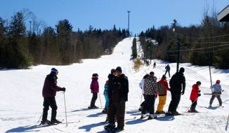 This undated photo shows people waiting in a lift ticket line in Mount Jefferson in Lee in northern Maine. Maine is home to a number of small, club- and family-run areas around the state where lift tickets can be had for $20 or less. Frugal skiers will also like the inexpensive extras available at some ski areas like 25-cent coffee and $1 grilled cheese sandwiches. (AP Photo/Betty Adams)