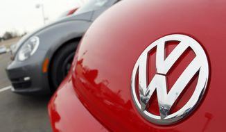 FILE - This Feb, 19, 2012 file photo shows the Volkswagen logo on the hood of a 2012 Beetle at a Volkswagen dealership in the south Denver suburb of Littleton, Colo. Volkswagen on Wednesday, Nov. 19, 2014 announced it is recalling 442,000 Jettas and Beetles to fix a problem that can cause rear suspension failure if the cars aren't fixed properly after a crash. The recall covers 2011 through 2013 Jettas and 2012 through 2013 Beetles. (AP Photo/David Zalubowski, File)
