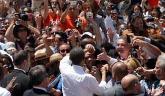 President Obama is mobbed by a crowd following a speech on immigration reform at Chamizal National Memorial Park in El Paso, Texas. [Associated Press]