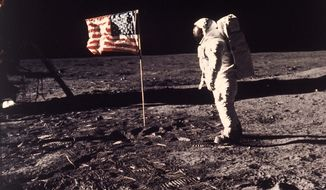 A July 20, 1969 photo from files made showing astronaut Edwin E. Buzz Aldrin Jr. posing for a photograph beside the U.S. flag deployed on the moon during the Apollo 11 mission. (AP Photo/NASA/Neil A. Armstrong, File) ** FILE **
