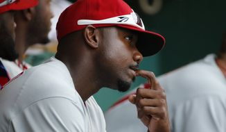 Philadelphia Phillies' Ryan Howard sits in the dugout during the ninth inning of a baseball game against the Pittsburgh Pirates in Pittsburgh Sunday, July 6, 2014. Howard had the day off. The Pirates won 6-2.(AP Photo/Gene J. Puskar)