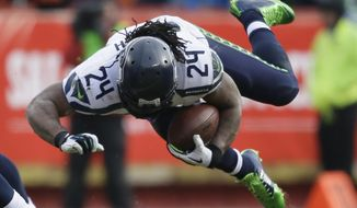 Seattle Seahawks running back Marshawn Lynch (24) stumbles in the first half of an NFL football game against the Kansas City Chiefs in Kansas City, Mo., Sunday, Nov. 16, 2014. (AP Photo/Charlie Neibergall)