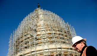 The Architect of the Capitol Stephen Ayers gives an update on the completion of the scaffolding and the start of repairs for the U.S. Capitol Dome Restoration Project at the roof of the U.S. Capitol Building, Washington, D.C., Tuesday, Nov. 18, 2014. (Andrew Harnik/The Washington Times)