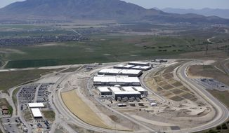 This June 6, 2013, file photo, shows the National Security Agency's Utah Data Center in Bluffdale, Utah. A Utah lawmaker is questioning whether city water should be shut off to a massive National Security Agency data-storage facility outside Salt Lake City. Republican Rep. Marc Roberts of Santaquin said he wants to explore whether the data center is getting any sweetheart deals on municipal water and power before a legislative committee hearing Wednesday afternoon. (AP Photo/Rick Bowmer, File)