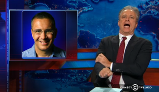 "Jon Stewart on Tuesday night railed against Obamacare ""architect"" Jonathan Gruber and the Democrats trying to distance themselves from him since comments resurfaced in which he insulted American voters. (Comedy Central)"