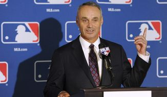 Major League Baseball Chief Operating Officer Rob Manfred speaks during a news conference after team owners elected him as the next commissioner of Major League Baseball during a quarterly owners meeting in Baltimore Thursday, August 14, 2014. (AP Photo/Steve Ruark)