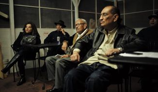 """A group of Hispanic people watch a television broadcast of President Barack Obama's speech on immigration at a Mexican restaurant Thursday, Nov. 20, 2014, in Los Angeles. President Barack Obama unveiled expansive executive actions on immigration Thursday night to spare nearly 5 million people in the U.S. illegally from deportation and refocus enforcement efforts on """"felons, not families."""" (AP Photo/Jae C. Hong)"""