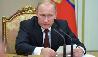 Russian President Vladimir Putin speaks at a Security Council meeting in the Kremlin in Moscow, Russia, Thursday, Nov. 20, 2014. The meeting discussed a strategy for fighting extremism. (AP Photo/RIA-Novosti, Alexei Druzhinin, Presidential Press Service)