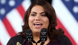 Immigration activist Astrid Silva introduces then-President Barack Obama before a speech on immigration at Del Sol High School Friday, Nov. 21, 2014, in Las Vegas. (AP Photo/Isaac Brekken) ** FILE **