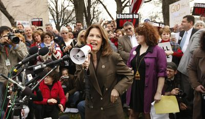 FILE - In this March 16, 2010 file photo, Rep. Michele Bachmann, R-Minn., speaks at a health care rally by The American Grassroots Coalition and The Tea Party Express on Capitol Hill in Washington. Ms. Bachmann stands ready to shake up next year's Republican nominating contest either through a campaign of her own or by wielding her influence over those who do run.  (AP Photo/Gerald Herbert, File)