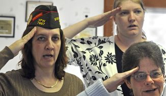 Veterans of Foreign Wars West Seneca Post 12097 members Marlene Roll, Beth Maddigan and Leonora Schreck, rear, salute the flag to start their monthly meeting in West Seneca, N.Y., a suburb of Buffalo, on Feb. 20, 2011. West Seneca Post 12097 is the first women's VFW Post in the United States. (Associated Press) **FILE**