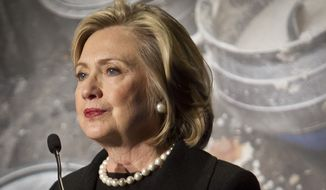 Hillary Rodham Clinton, former US Secretary of State, speaks during her keynote remarks at the Global Alliance for Clean Cookstoves  summit, Friday Nov. 21, 2014 in New York.  (AP Photo/Bebeto Matthews)