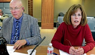 Spaceport executive director Christine Anderson gives her report to members of a legislative finance oversight committee at the New Mexico State capitol on Thursday, Nov. 20, 2014. Richard Holdridge, left, chairman of theBoard of Directors, Spaceport Authority appeared with Anderson. (AP Photo/The New Mexican, Clyde Mueller)