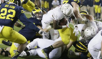 Maryland running back Wes Brown (4) falls into the end zone for a touchdown during the second half of an NCAA college football game against Michigan in Ann Arbor, Mich., Saturday, Nov. 22, 2014. (AP Photo/Carlos Osorio)