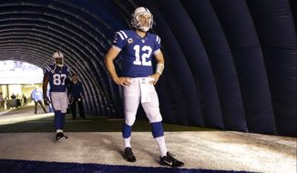 Indianapolis Colts quarterback Andrew Luck (12) waits to be introduced before an NFL football game against the Jacksonville Jaguars Sunday, Nov. 23, 2014 in Indianapolis. (AP Photo/AJ Mast)