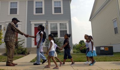 Council member Marion Barry greets students from the Turner Elementary School summer program, as they walk through Henson Ridge, a new affordable housing unit in Southeast on July 25, 2006. (Nancy Pastor/The Washington Times)