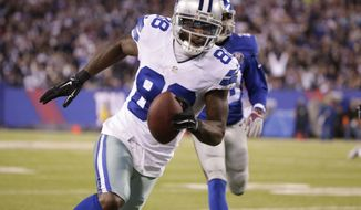 Dallas Cowboys wide receiver Dez Bryant (88) takes the ball to the end zone for a touchdown against the New York Giants in the third quarter of an NFL football game, Sunday, Nov. 23, 2014, in East Rutherford, N.J. (AP Photo/Julio Cortez)