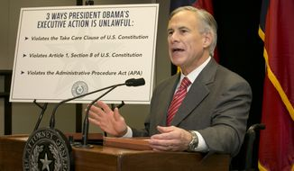 Texas Attorney General and Gov.-elect Greg Abbott speaks against President Barack Obama's executive order on immigration at the Price Daniel Building in Austin, Texas, on Monday, Nov. 24, 2014. Abbott is again vowing to sue the Obama administration for lifting the threat of deportation from millions of immigrants living illegally in the United States. (AP Photo/Austin American-Statesman, Jay Janner)