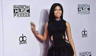Nicki Minaj arrives at the 42nd annual American Music Awards at Nokia Theatre L.A. Live on Sunday, Nov. 23, 2014, in Los Angeles. (Photo by John Shearer/Invision/AP)