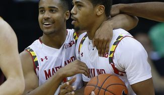 Maryland guard Melo Trimble (left) hugs Richaud Pack after Pack was fouled in the final minutes in the second half of the CBE Hall of Fame Classic game against Arizona State on Monday in Kansas City, Mo. Maryland won 78-73. (Associated Press)