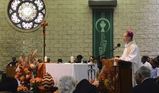 "In this Sunday, Nov. 23, 2014, Archbishop Blase Cupich speaks at St. Agatha Catholic Church in Chicago during Mass. During his homily, Chicago's new archbishop apologized to parishioners at the West Side church where children were sexually abused by a priest, saying his heart breaks for those injured by the ""horrible things"" that happened. (AP Photo/Sun-Times Media, Brian Jackson) MANDATORY CREDIT, MAGS OUT, NO SALES"