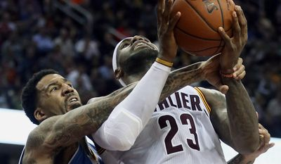 Cleveland Cavaliers LeBron James is fouled by Denver Nuggets Wilson Chandler during an NBA basketball game Monday, Nov. 17, 2014, in Cleveland, Ohio. (AP Photo/Akron Beacon Journal, Phil Masturzo)  MANDATORY CREDIT