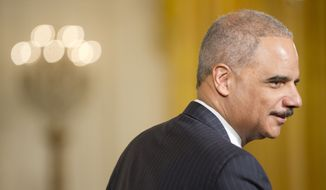 Attorney General Eric Holder takes his seat as he attends the ceremonies for the Presidential Medal of Freedom, Monday, Nov. 24, 2014, in the East Room of the White House in Washington. (AP Photo/Pablo Martinez Monsivais)