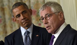 President Barack Obama, left, listens as Defense Secretary Chuck Hagel, right, talks about his resignation during an event in the State Dining Room of the White House in Washington, Monday, Nov. 24, 2014. Hagel is stepping down under pressure from Obama's Cabinet, senior administration officials said Monday, following a tenure in which he has struggled to break through the White House's insular foreign policy team. (AP Photo/Susan Walsh)