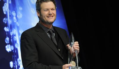 Blake Shelton's new holiday album features contributions from his wife, Miranda Lambert, as well Reba McEntire and even his mom, Dorothy Shackleford. (Photo by Evan Agostini/Invision/AP)