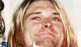 FILE - Lead singer of the US rock band Nirvana Kurt Cobain is shown in a 1993 file photo. Cobain is the focus of a new documentary that probes the life and untimely death of the Nirvana singer-guitarist. It will be released in theaters next year and air exclusively on HBO, the network said Tuesday, Nov. 25, 2014. (AP Photo/Mark J.Terrill, File)