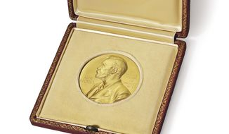 This image provided by Christie's auction house shows the 1962 Nobel Prize medal James Watson won for his role in the discovery of the structure of DNA. The medal is going on the auction block Dec. 4, 2014 at Christie's. (AP Photo/Christie's)
