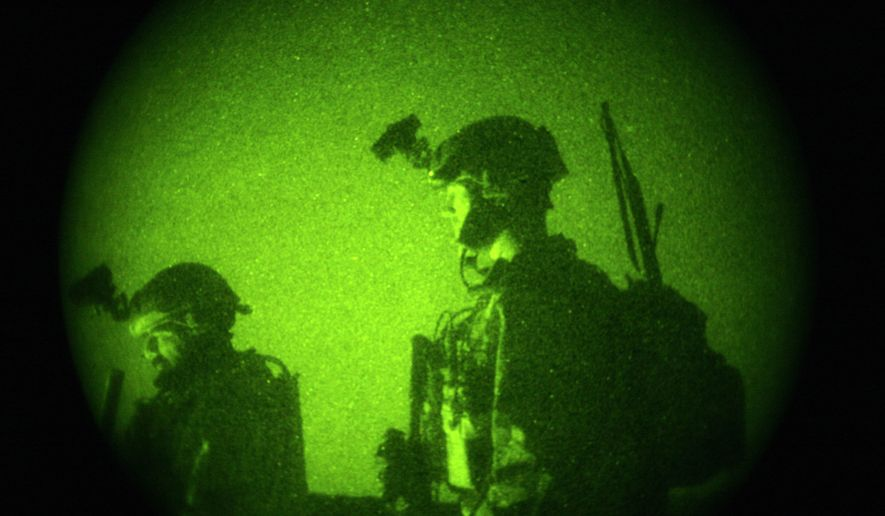 U.S. Special Operations forces engage in a joint operation with Afghan National Army soldiers targeting insurgents operating in Afghanistan's Farah province, Oct. 29, 2009. (Associated Press) ** FILE **