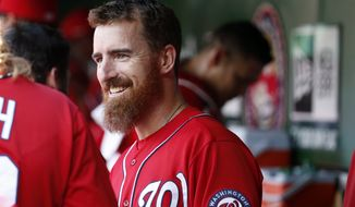 Washington Nationals first baseman Adam LaRoche smiles in the dugout before a baseball game against the Philadelphia Phillies at Nationals Park, Saturday, Sept. 6, 2014, in Washington. (AP Photo/Alex Brandon)