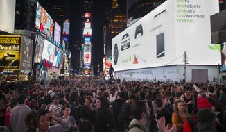Protesters fill Times Square during a march after the announcement of the grand jury decision not to indict Ferguson police officer Darren Wilson in the fatal shooting of Michael Brown, an unarmed black 18-year-old, Monday, Nov. 24, 2014, in New York. (Associated Press)
