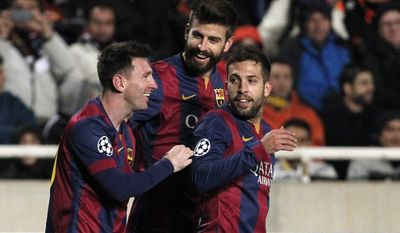 Barcelona's Lionel Messi, left, celebrates with Gerard Pique and Jordi Alba scoring his side's 3rd goal during a Champions League Group F soccer match between APOEL and FC Barcelona at GSP stadium, in Nicosia, Cyprus, Tuesday, Nov. 25, 2014. (AP Photo/Petros Karadjias)