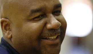 Head coach John Thompson III smiles during a media availability during Georgetown University basketball media day, Thursday, Oct. 23, 2014, in Washington. (AP Photo/Alex Brandon)