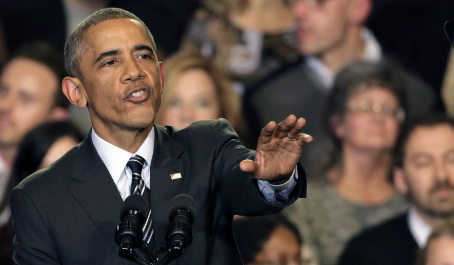 President Obama tries to quiet one of three hecklers as he addresses the crowd after meeting with community leaders about the executive actions he is taking to fix the immigration system Tuesday, Nov. 25, in Chicago. (Associated Press)