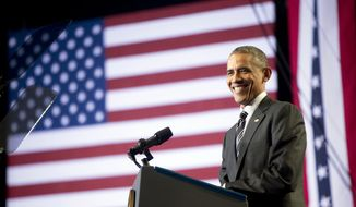 President Barack Obama smiles while speaking at the Copernicus Community Center in Chicago to discuss immigration reform, Tuesday, Nov. 25, 2014. Obama visited his hometown to promote his executive action on immigration. (AP Photo/Pablo Martinez Monsivais)