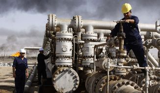 In this Dec. 13, 2009, file photo, oil personnel work at the Rumaila oil refinery, near the city of Basra, Iraq. OPEC's purpose is to coordinate oil output to keep prices high and stable, to maximize member countries' revenue but make sure global demand for oil stays strong. A steep, coordinated cut in output could stop and possibly reverse what has been a 30 percent decline in price over five months. (AP Photo/Nabil al-Jurani, File)FILE