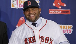 Newly acquired Boston Red Sox free agent third baseman Pablo Sandoval smilies as he is introduced to the media at Fenway Park Tuesday, Nov. 25, 2014, in Boston. (AP Photo/Stephan Savoia)